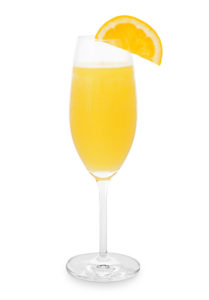 Mimosa glass with orange slice isolated on white